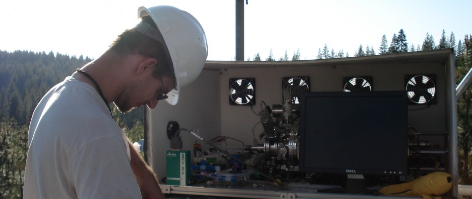 Glenn putting the CIMS together on the tower at Blodgett Forrest Research station in California.